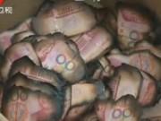 Tin tức - TQ: Người vợ đốt 350 triệu đồng giấu trong bếp vì quên