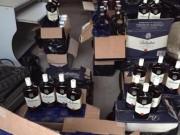 CSGT phát hiện hàng trăm chai rượu và gỗ lậu