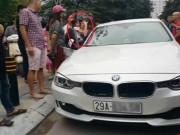 Tin tức - Bố dùng búa đập vỡ kính xe BMV để giải cứu con gái