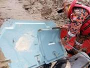 Tin tức - Tìm thấy thi thể và mảnh vỡ máy bay Malaysia mất tích