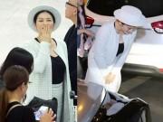 Thời trang - Lý Nhã Kỳ mặc kín bưng, cúi đầu chào fan tại sân bay