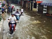 Tin tức - Mưa suốt đêm, nhiều tuyến phố Hà Nội ngập sâu