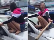 Tin tức - Vợ nhảy lên nắp capô đánh ghen chồng và bạn thân