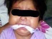 Tin tức - Bé gái 9 tháng tuổi bị mẹ và giúp việc bịt miệng, trói tay rồi đăng lên Facebook