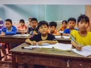 Tin tức - Cô giáo ngồi xe lăn gieo chữ nơi xóm nghèo