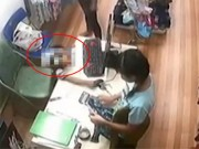 Clip Eva - Video: Người phụ nữ xúi bé trai ăn trộm tiền trong tiệm quần áo