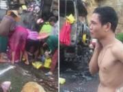 Tin tức - Mặc tài xế khóc van xin, đám đông vẫn lao vào hôi của trên xe chở hàng bốc cháy dữ dội