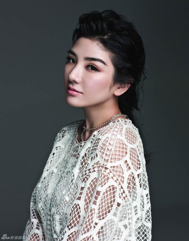 Huỳnh Dịch khoe nhan sắc gái một con trong những khuôn hình mới nhất của năm 2014