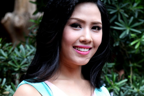 nguyen thi loan tang can sau khi tro ve tu miss world - 10