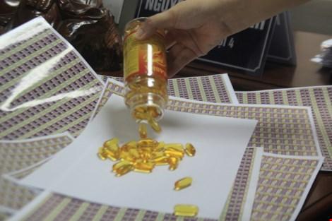 Bắt lô dầu cá Omega 3 giả do Trung Quốc sản xuất-3