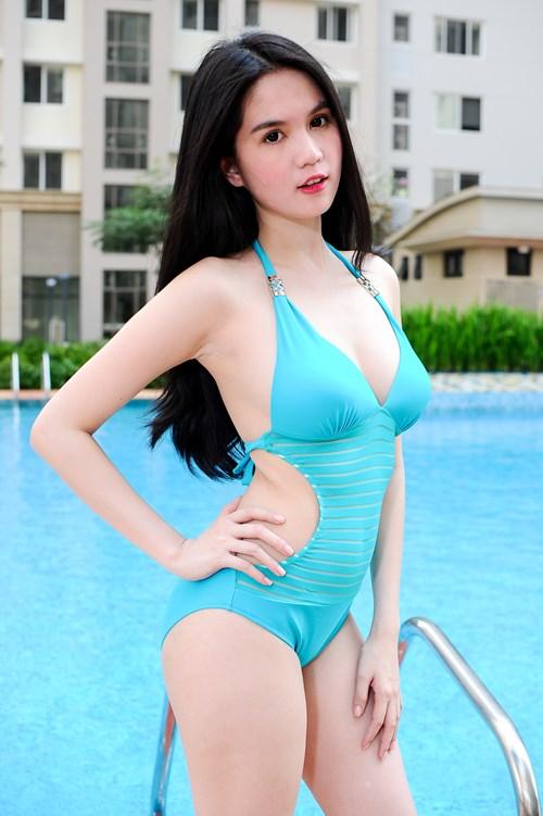 "ngoc trinh lai ""gay thuong nho"" voi bikini - 6"