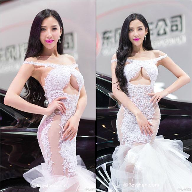 Người mẫu xe hơi nổi tiếng Hàn Phán Phán đã khiến mọi người 'nóng mắt' với thời trang táo bạo của mình tại triển lãm xe hơi.