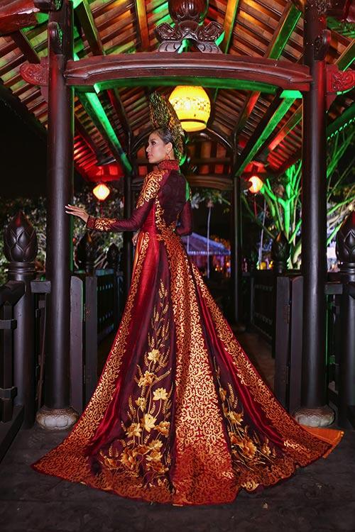 """Á hậu Trương Thị May """"mặc lại"""" áo dài từng thi Miss Universe 2013-9"""