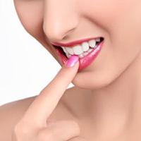 6 triệu chứng lão hóa răng