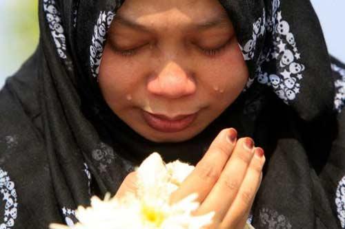 malaysia roi le don thi the nan nhan mh17 - 5