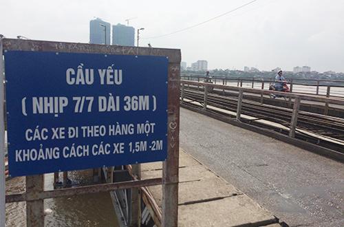 vat va duoi nang nong gia co cau long bien - 2