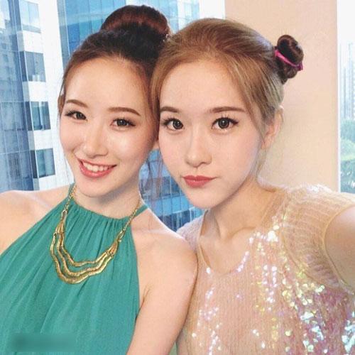 cap chi em song sinh tao 'song' vi giong het my nu han - 8