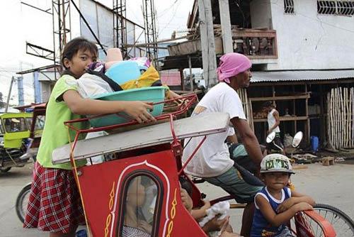 anh: nguoi dan philippines hoang so tranh bao hagupit - 10