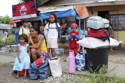 anh: nguoi dan philippines hoang so tranh bao hagupit - 9