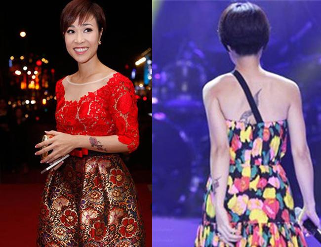 Uyên Linh cũng táo bạo không kém, hình xăm đậm chất chơi sau lưng cô phần nào hé lộ cá tính của ca sĩ.