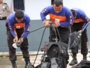 Tin tức - Nạn nhân QZ8501 vẫn ngồi ghế, thắt dây an toàn