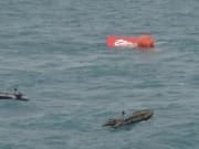 Tin quốc tế - Đuôi máy bay QZ8501 đã nổi trên mặt biển