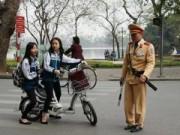 Tin tức - Từ 10/4, đi xe đạp điện phải đội mũ bảo hiểm