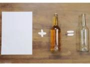 Bếp Eva - Mẹo bật nắp chai chỉ bằng một tờ giấy