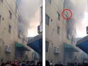 Tin tức - Video: Mẹ thả 3 con nhỏ từ tầng 4 xuống để thoát đám cháy
