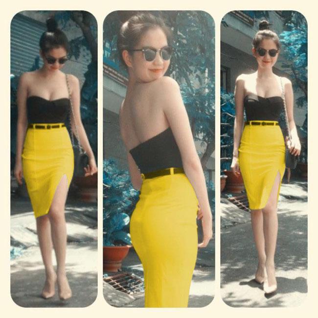 Style chân váy bút chì màu vàng ngọt ngào mix cùng áo quây đen nổi bật, khoe da trắng vai thon của Ngọc Trinh.