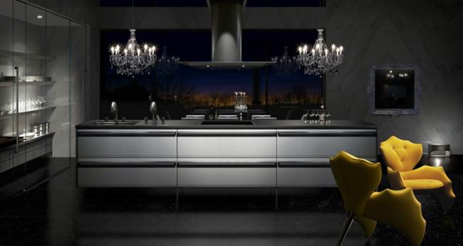 Khu bếp nấu và tủ bếp bằng thép không gỉ 'sâu hút', được nhấn nhá bằng bộ bàn ăn màu vàng rực rỡ.