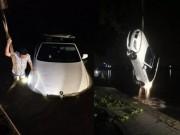 Tin tức - Mải dùng điện thoại, tài xế lao thẳng xe BMW xuống hồ