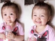 Làng sao - Con gái Elly Trần cười tít mắt khi tự uống sữa bình