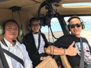 Vợ chồng siêu mẫu Ngọc Thạch cực sang chảnh khi ngồi trực thăng ngắm cảnh ở Úc