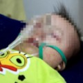 Tin tức - Nỗi đau của người cha bế đứa con bất động vì sởi