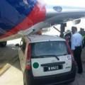 Tin tức - Máy bay Malaysia Airlines hoãn chuyến vì va chạm
