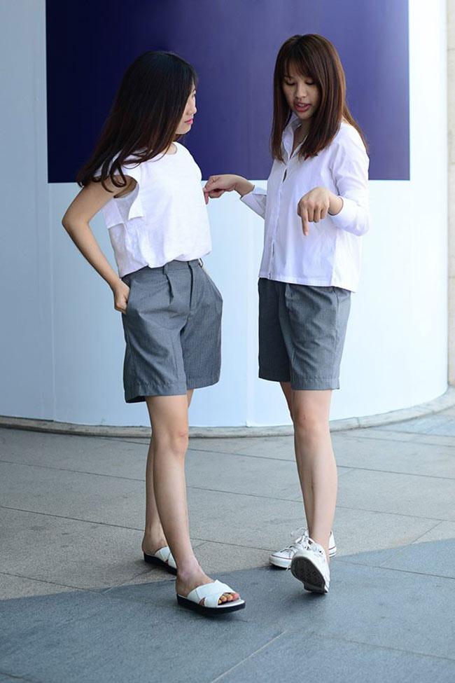 Sơ mi hay áo kiểu màu trắng mặc cùng quần sooc thực sự thu hút phái đẹp trong mùa hè.