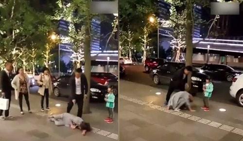 Phẫn nộ cảnh chồng đánh vợ trước mặt con ngoài đường-1