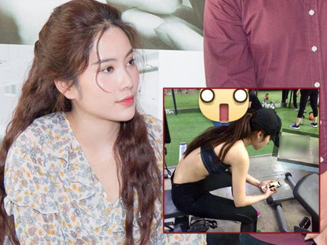 Hình ảnh cô gái được cho là Nam Em đang ngồi xem ảnh Trường Giang tại phòng tập gym