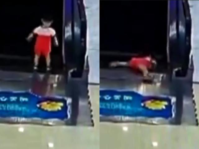 Khoảnh khắc kinh hoàng: Không có người trông, bé gái kẹp tay vào thang cuốn đang di chuyển