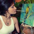 Tin tức - Cô gái khuyết tứ chi vẽ tranh bằng miệng tuyệt đẹp