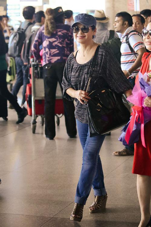Vợ chồng Khánh Ly gây chú ý ở sân bay - 12