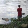 Tin tức - Xác chết tay bị cột vào bao tải đá nổi trên sông SG