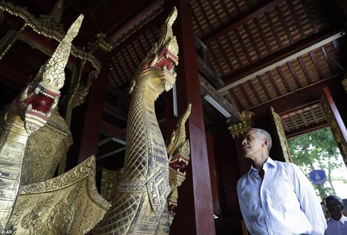 tong thong obama dao pho, uong nuoc dua o lao - 1