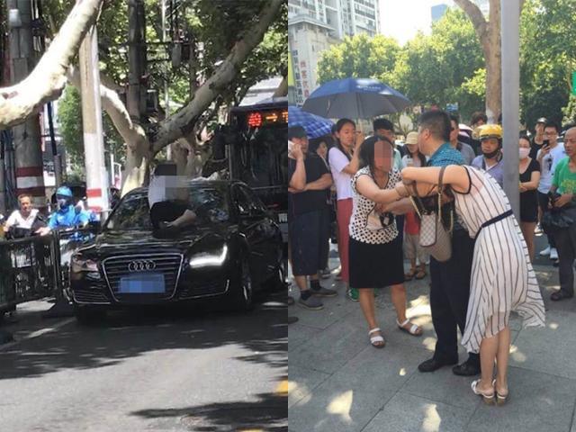 Vợ nhảy lên mui xe đánh ghen, nhân tình vẫn ung dung ngồi trong ô tô cầm túi hàng hiệu
