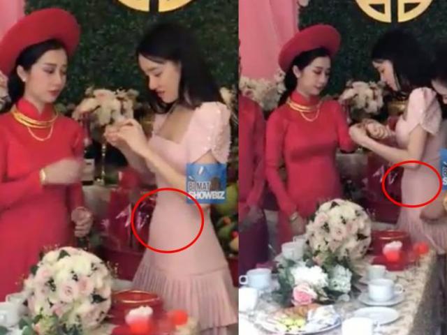 Nhã Phương lộ bụng to bất thường khi mặc váy bó trao quà cưới cho em gái