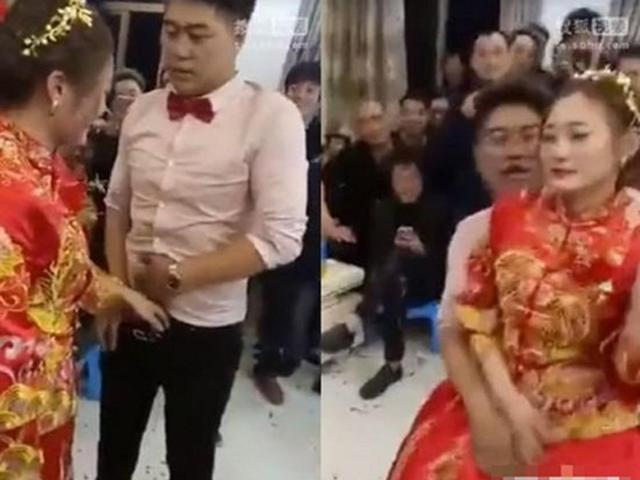 Bị quan khách ép, cô dâu chú rể ngại ngùng đụng chạm vùng nhạy cảm của nhau trong đám cưới