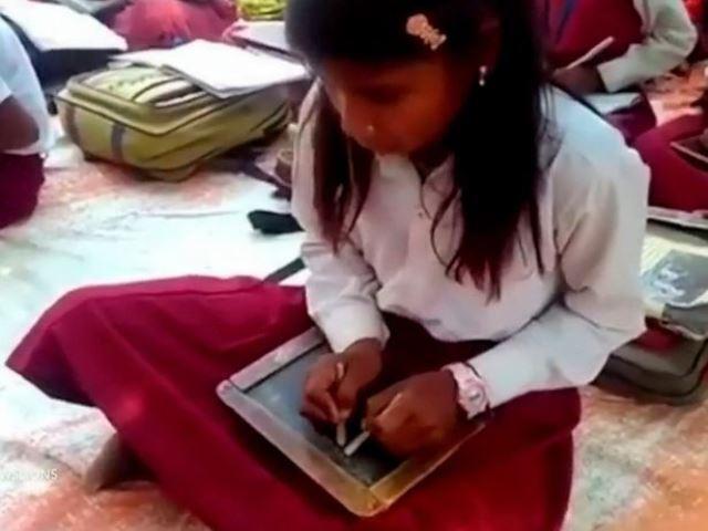 Trường dạy học sinh viết cùng lúc hai tay, mỗi tay một ngôn ngữ và lý giải của hiệu trưởng