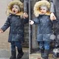 Làng sao sony - Nhóc Flynn thích thú ngắm tuyết rơi