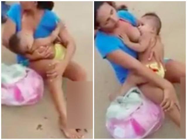 Bị gãy chân vì tai nạn, bà mẹ vẫn vạch áo ngồi cạnh đường cho con bú